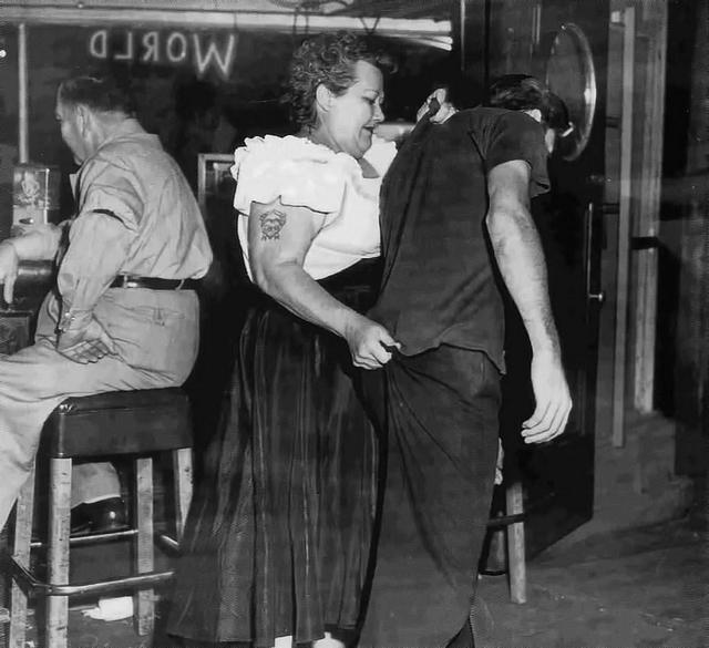 1953_cairo_mary_bouncer_at_shanghai_reds_5th_and_beacon_in_san_pedro_ca_escorts_a_customer_to_the_door.jpg