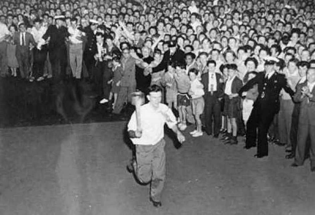 1956_olympic_torch_relay_vet_student_barry_larkin_tricked_lookers_by_carrying_a_fake_torch_made_of_a_chair_leg_pudding_can_and_flaming_underpants_he_managed_to_hand_it_over_to_the_mayor_of_sydney.jpg