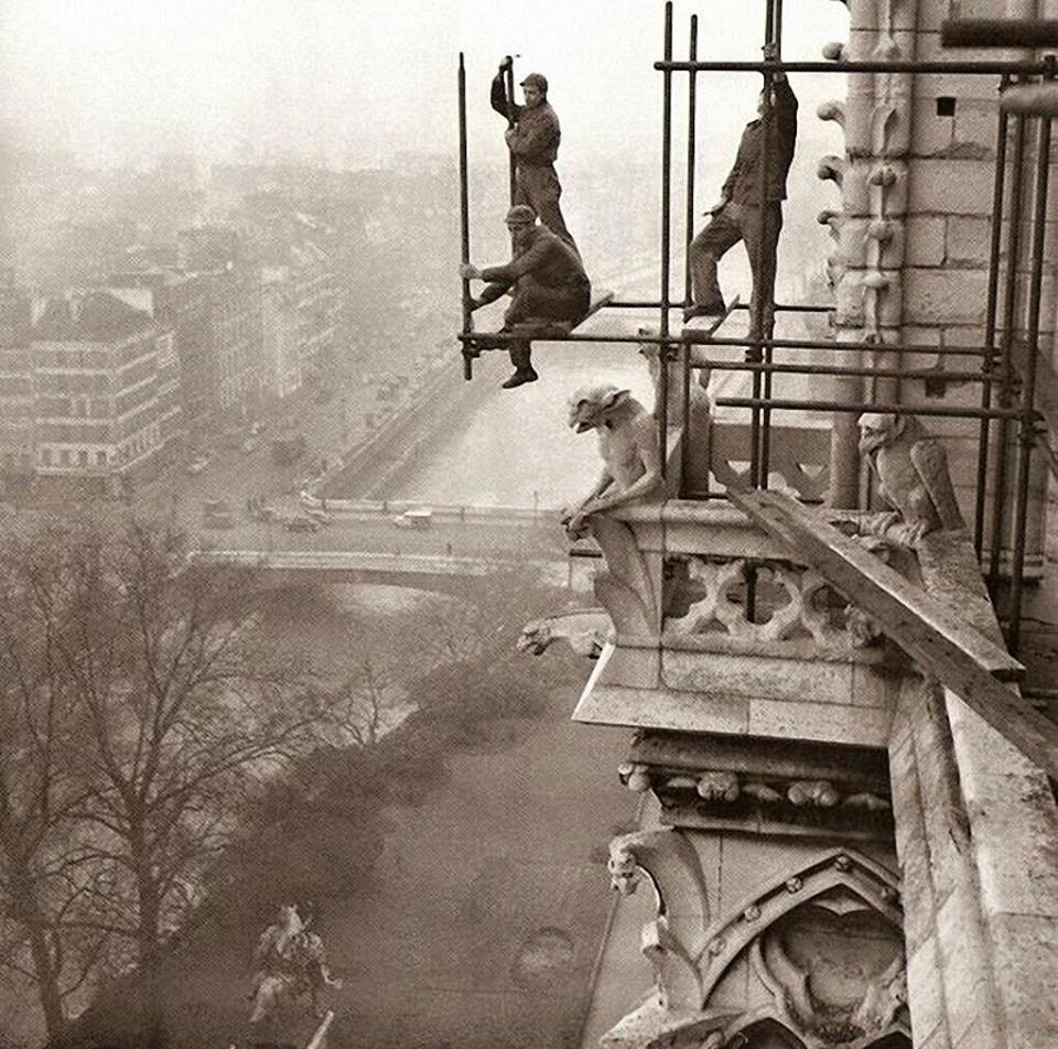 workers_on_rickety_scaffolding_during_the_restoration_of_notre_dame_paris_1952.jpg