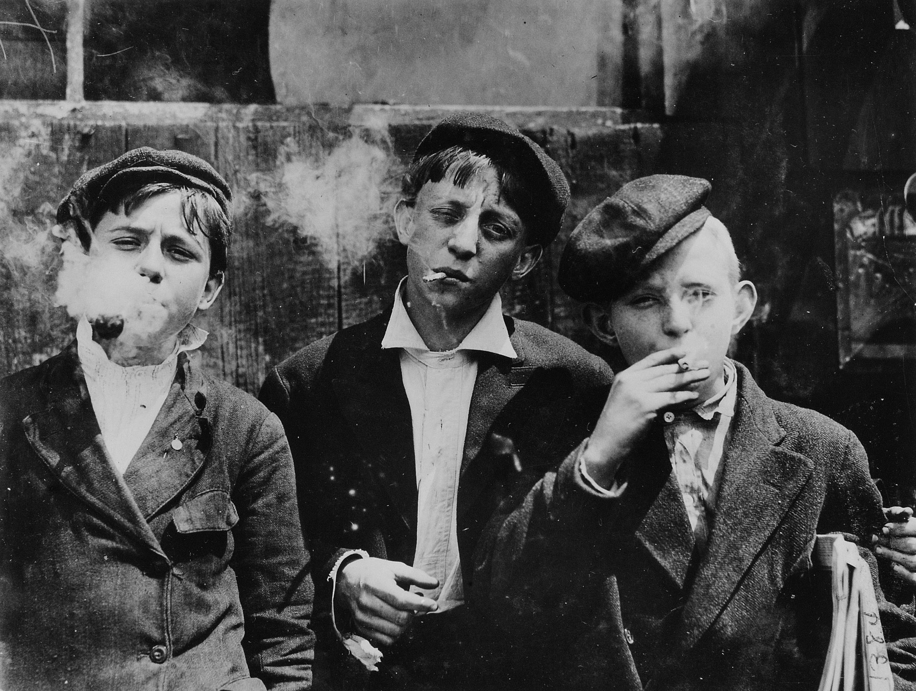 1100_a_m_monday_may_9th_1910_newsies_at_skeeter_s_branch_jefferson_near_franklin_they_were_all_smoking_location_st_louis_missouri.jpg