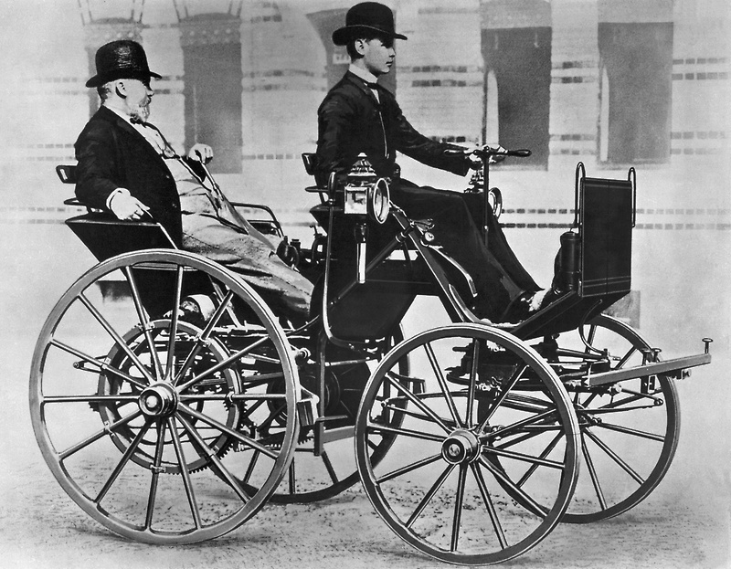 gottlieb_daimler_and_his_son_adolf_on_the_motor_car_motor_carriage_1886.jpg