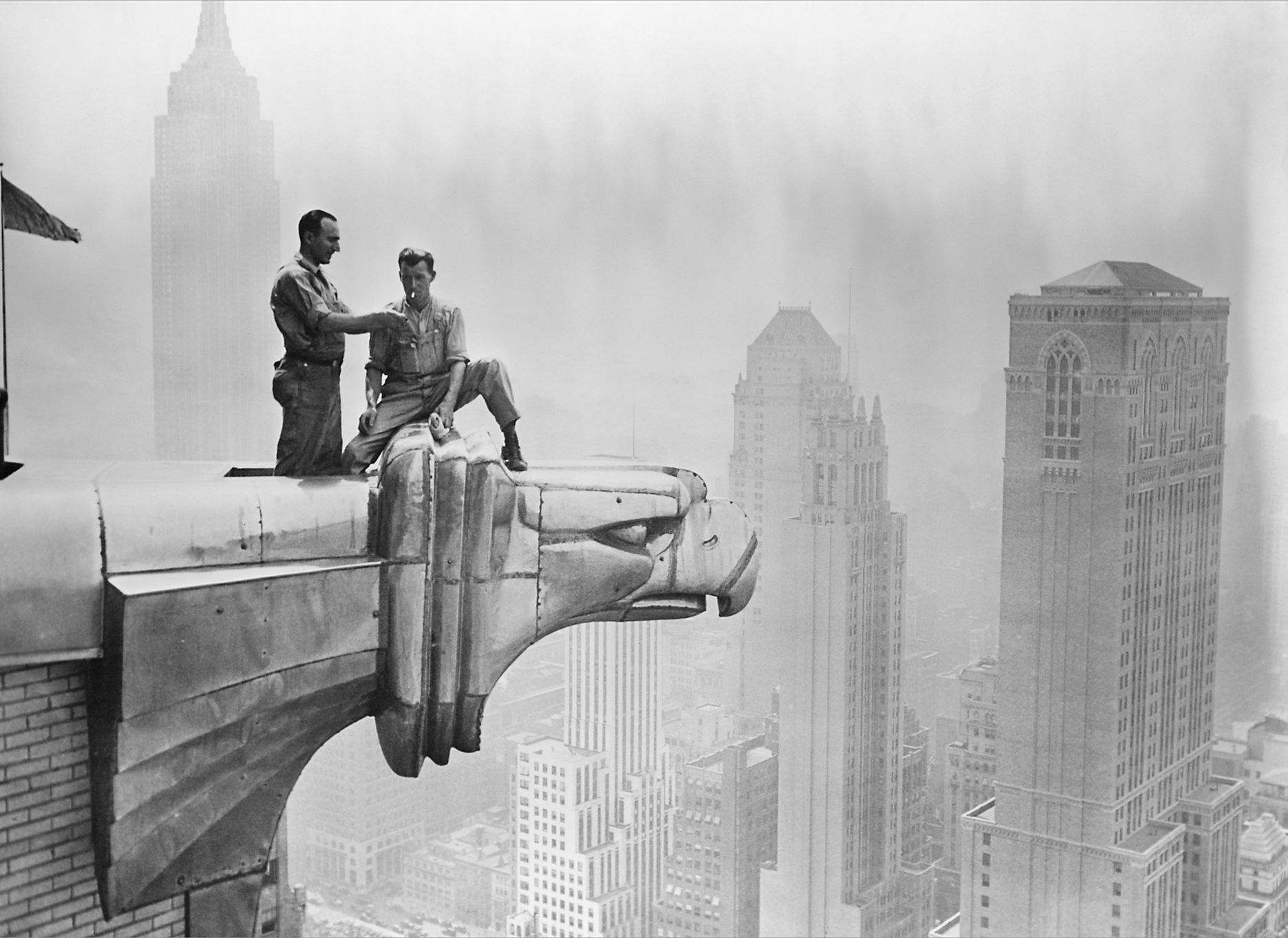 workers_smoking_on_a_chrysler_building_gargoyle_new_york_city_ca_1940_photo_by_tony_strachan.jpg