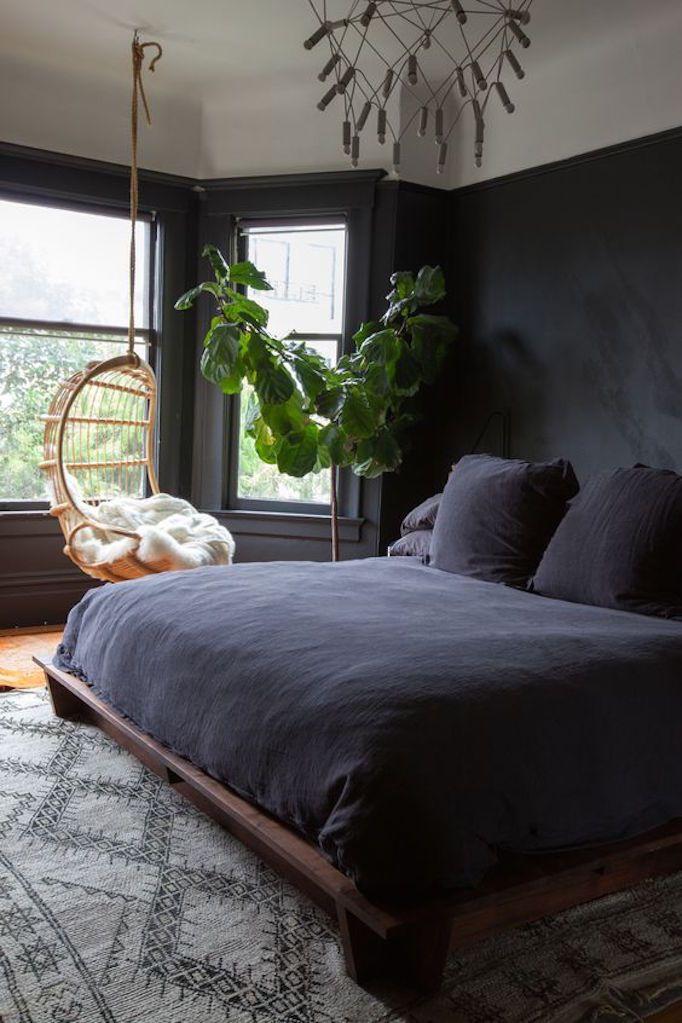 becki-owens-dark-and-moody-bedroom-with-rattan-swing.jpg