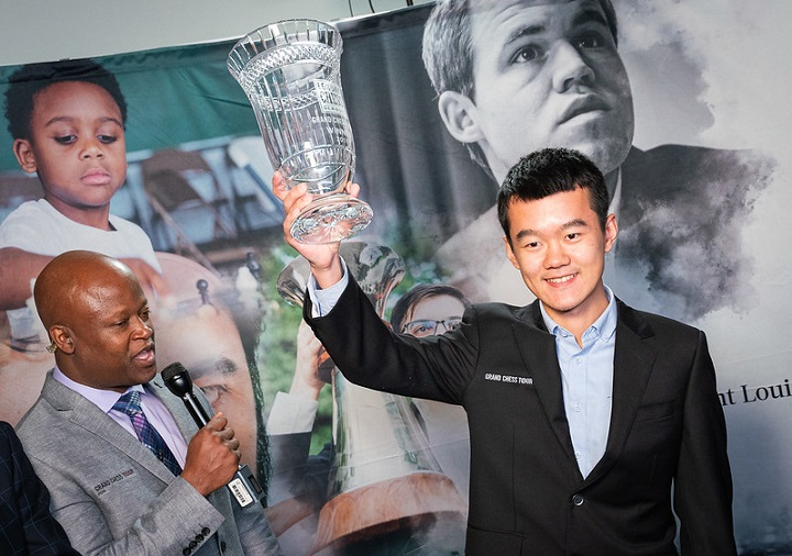 ding-liren-holds-up-trophy.jpg