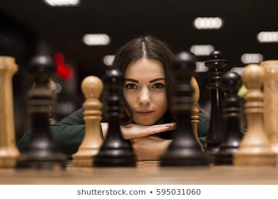 beautiful-girl-playing-chess-260nw-595031060.jpg