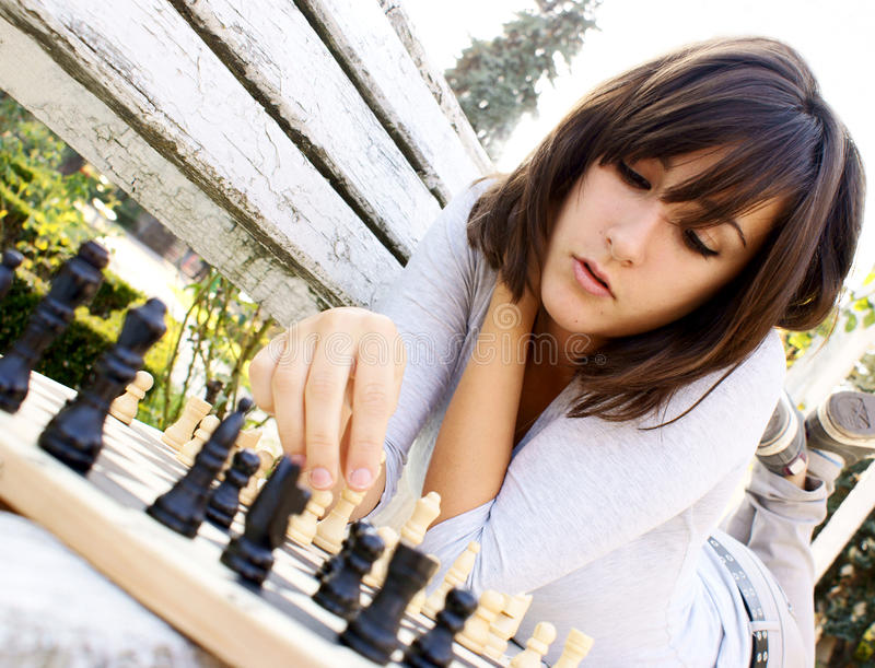 young-beautiful-woman-playing-chess-16607884.jpg