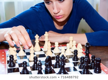 young-woman-makes-move-chess-260nw-716488792.jpg