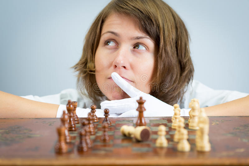 young-woman-nurse-doctor-playing-chess-checkmate-thinking-game-pieces-beautiful-pretty-female-white-robe-gloves-moving-cunning-76811144.jpg