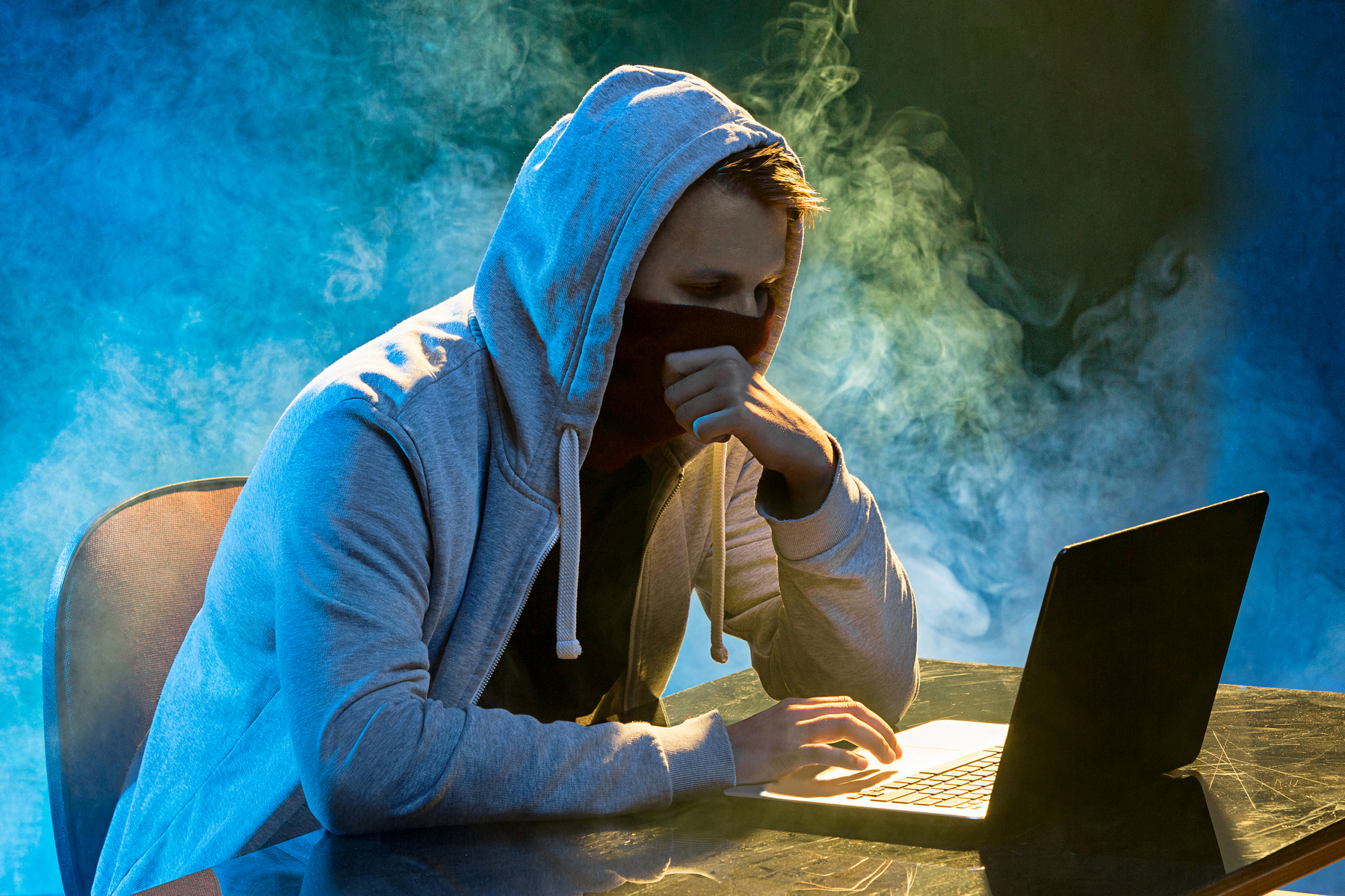 hooded-computer-hacker-stealing-information-with-p9u3l2p.JPG