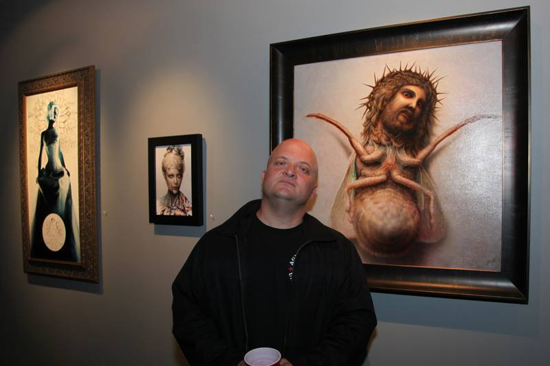 18-TOME 2 Melancholia Opening Reception Steven in front of Paul Booth's Dominus MuscaePhotography by Paola Duran.jpg