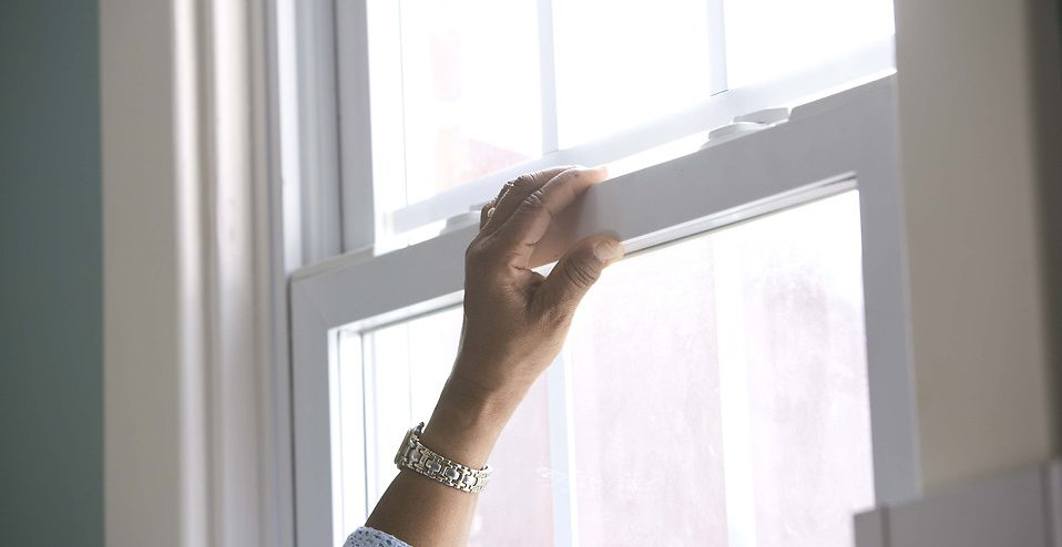 16330-an-african-american-woman-cleaning-a-window-pv.jpg