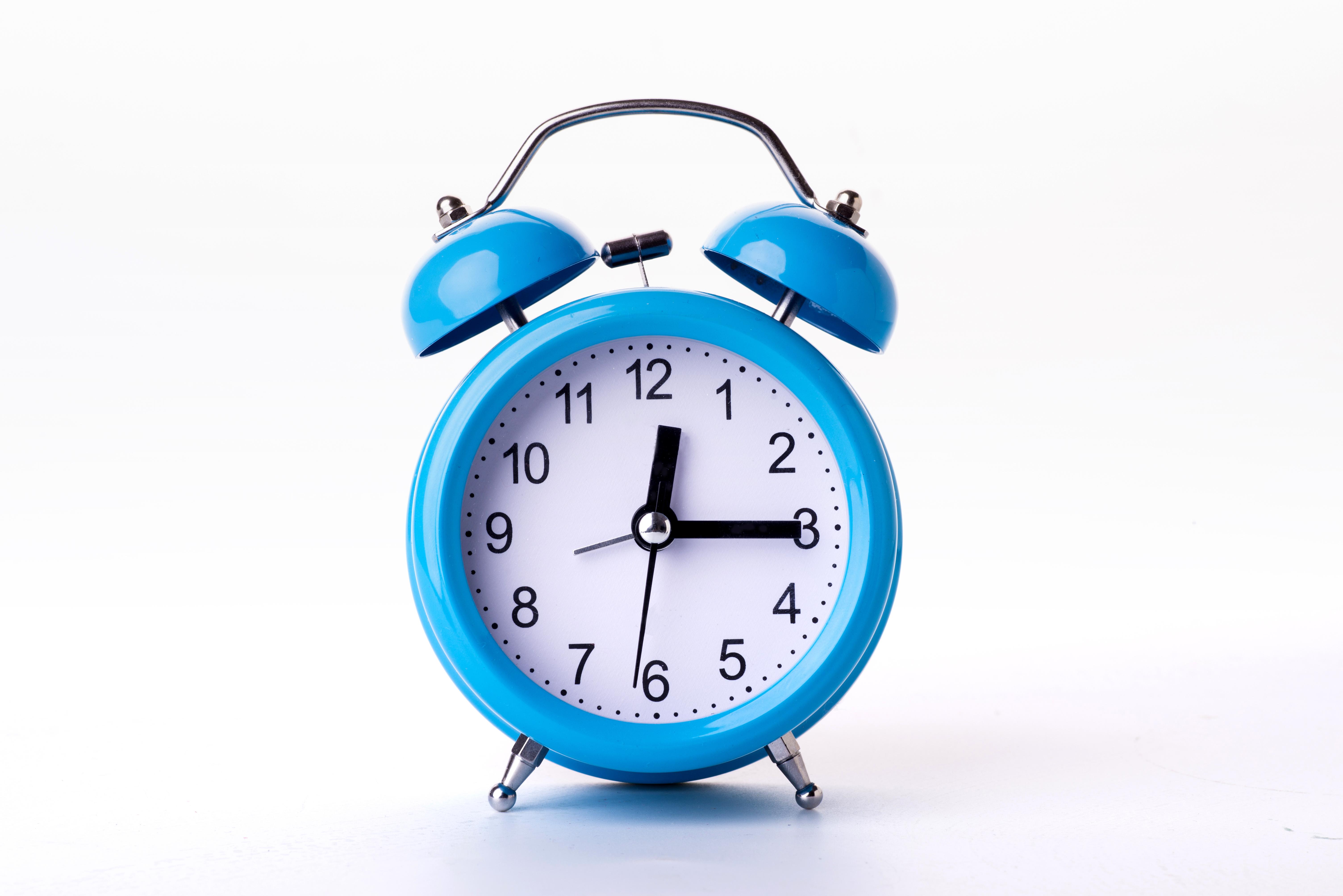 blue-alarm-clock-on-white-background.jpg
