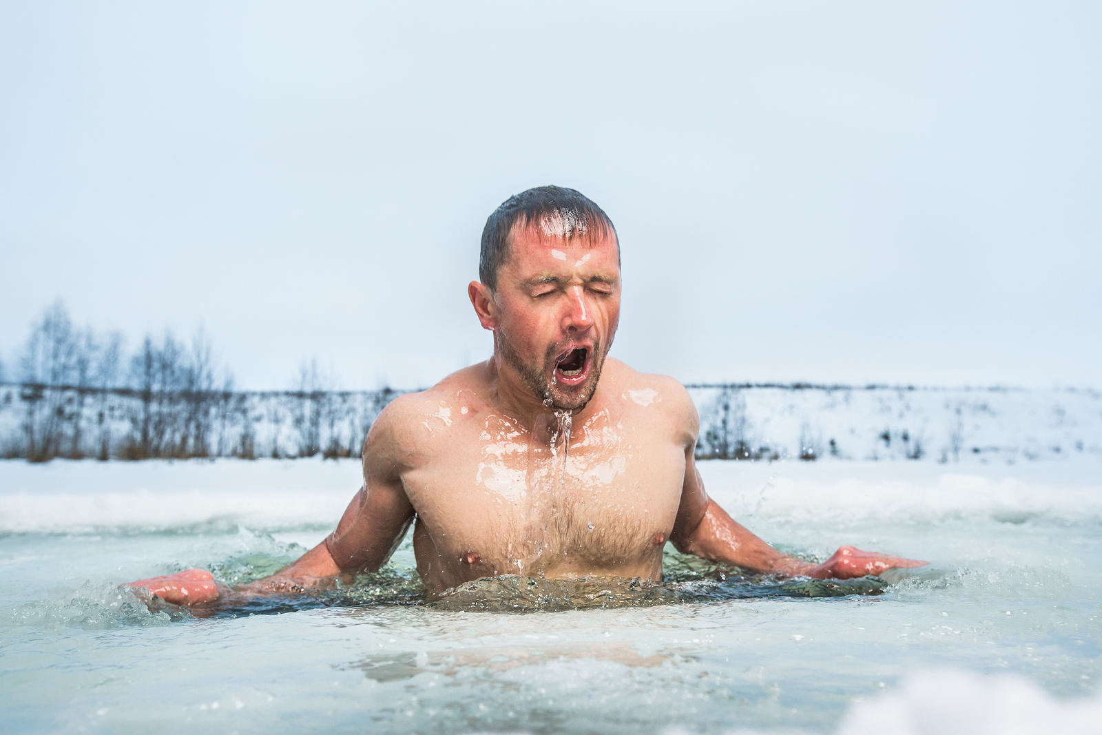 bigstock-young-man-swimming-in-the-wint-150549422.jpg