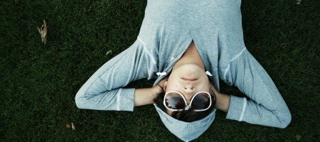 woman-in-sunglasses-lying-on-bed.jpg