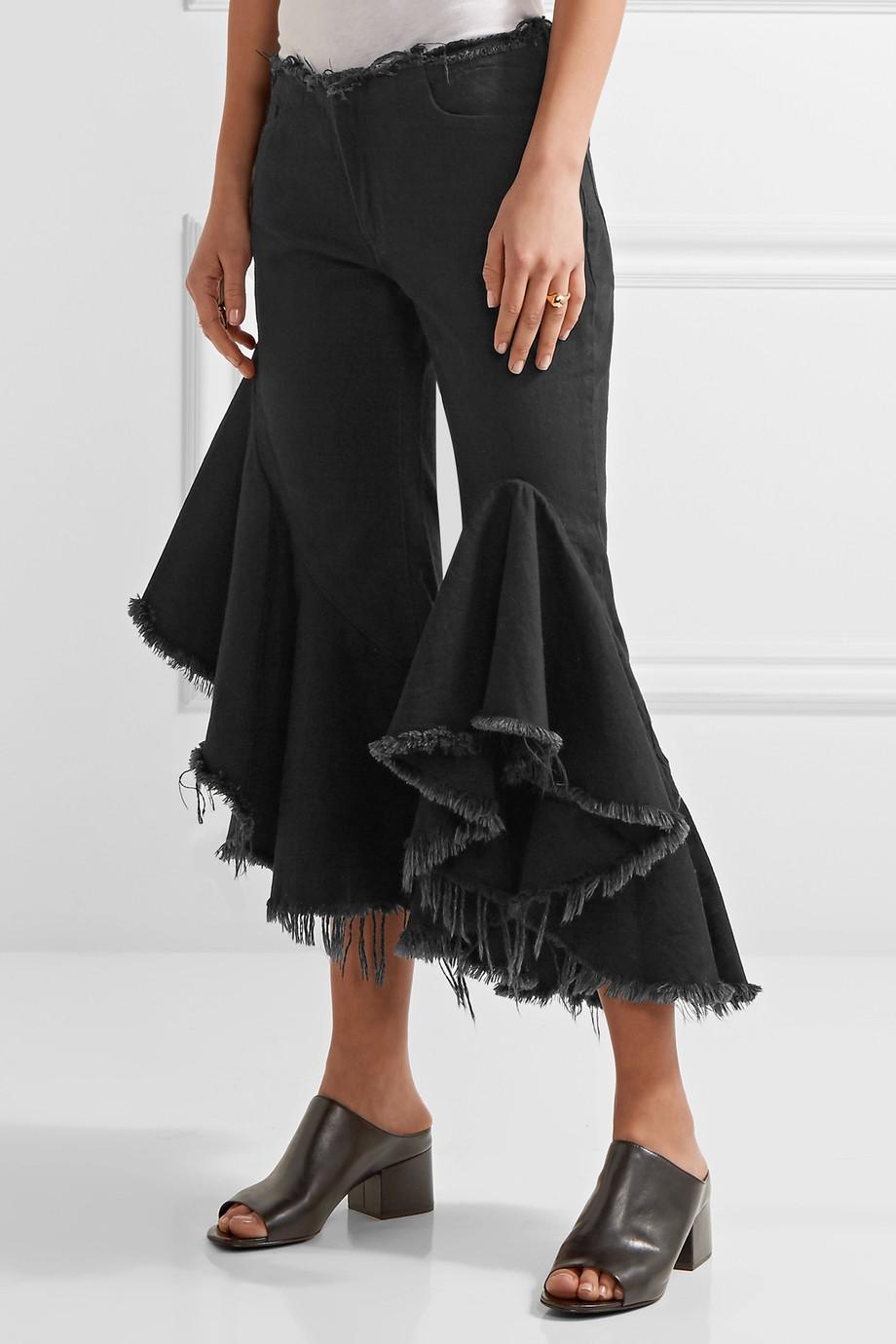 Mega-giga fodrok, <a href='https://www.net-a-porter.com/hu/en/product/805290/Marques_Almeida/ruffled-frayed-low-rise-flared-jeans' target='_blank'>Marques' Almeida</a></p>