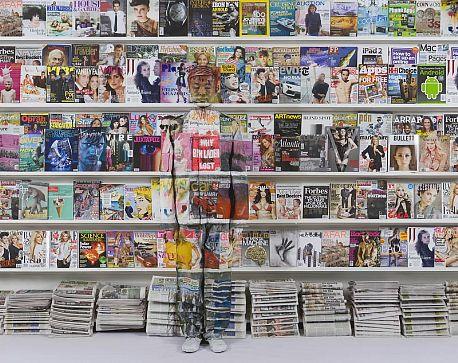 _publish_worksimages_Liu_Bolin_Hiding_in_New_York_No.3_Magazine_Rack_2011_LG.jpg
