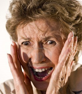 6610454-senior-woman-in-her-70s-with-frightened-look-on-her-face.jpg