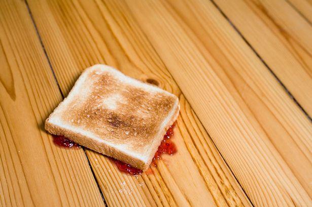 slice-of-toast-with-strawberry-jam-upside-down-on-floor.jpg