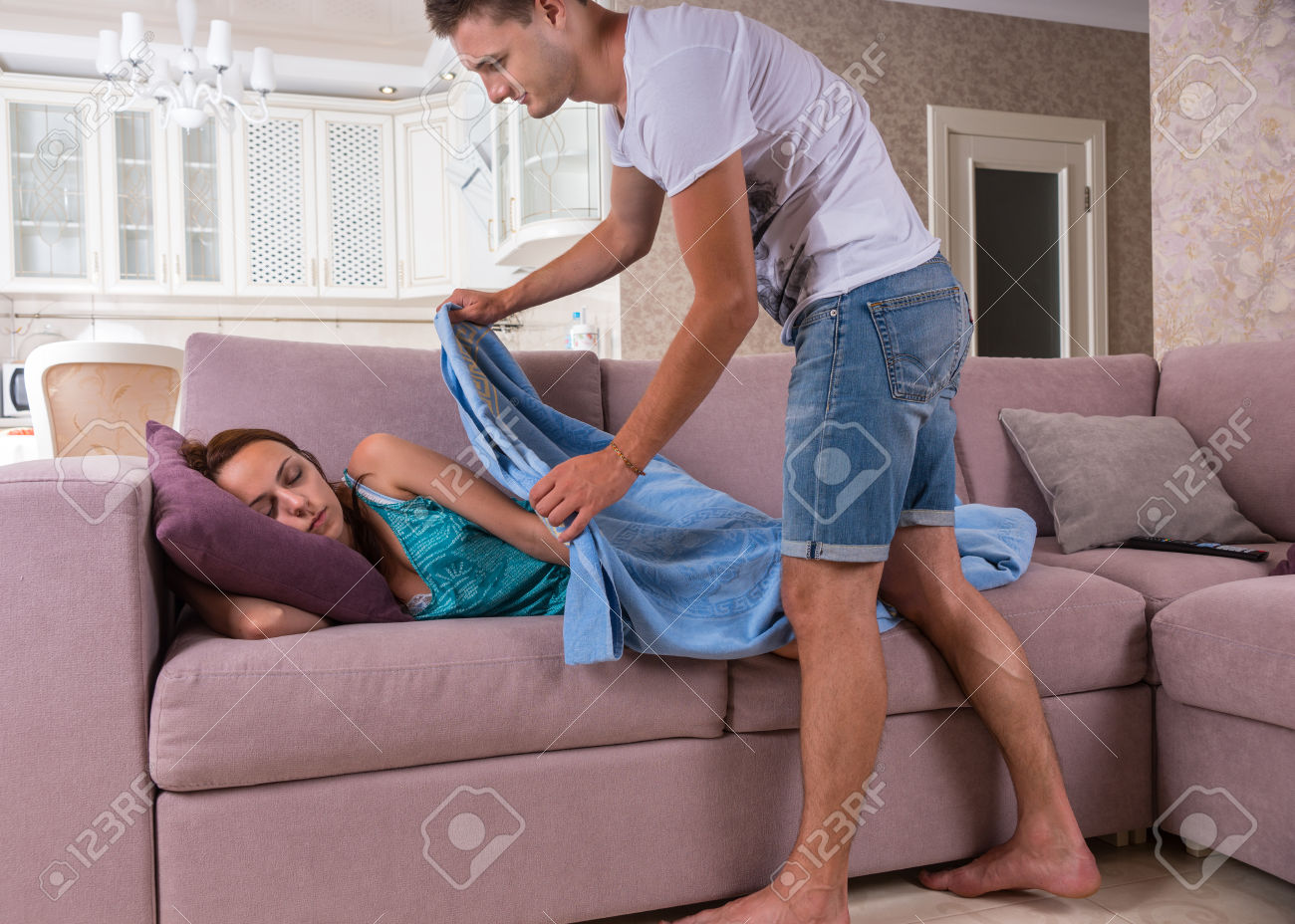 45319431-young-man-covering-up-young-sleeping-woman-with-cozy-blue-blanket-taking-care-of-woman-resting-on-so-stock-photo.jpg
