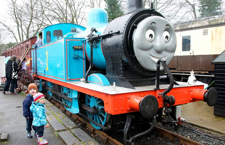 children-posing-with-thomas-train.jpg