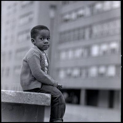 A boy sits outside the Pruitt-Igoe Housing Project, 1960's. Courtesy of St. Louis Public Schools.jpg