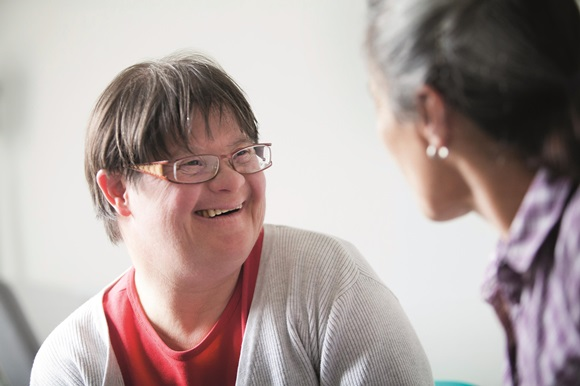1070002_adult-downs-syndrome-talking-to-carer-15.jpg