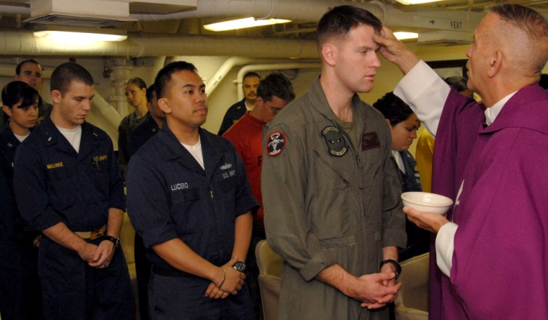 us_navy_090225-n-8283s-018_sailors_and_marines_prepare_to_receive_ashes_during_ash_wednesday_mass_aboard_the_amphibious_assault_ship_uss_boxer_lhd_4.jpg