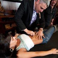 AJ Fernandez rolling a cigar on Outlaw Calender girls stomach