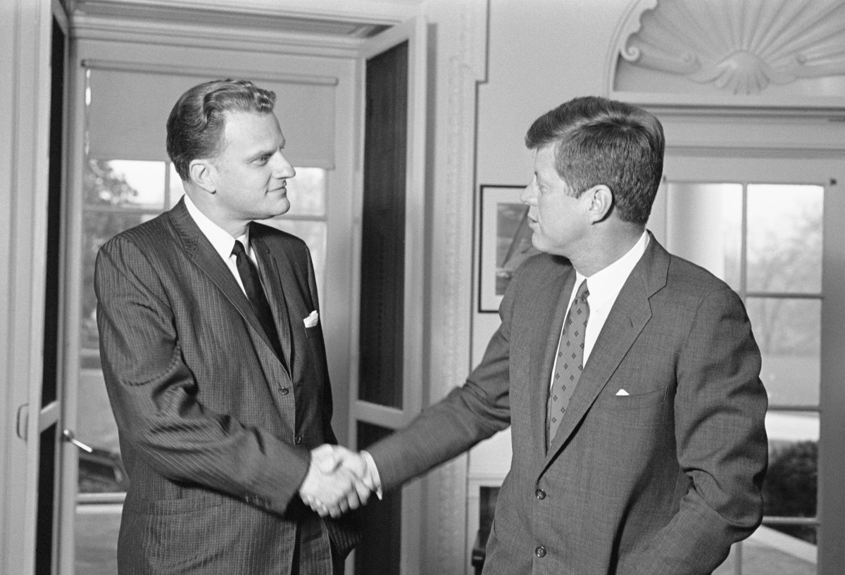 evangelist-billy-graham-chats-with-president-john-kennedy-during-an-unannounced-visit-to-the-white-house-today-getty.jpg