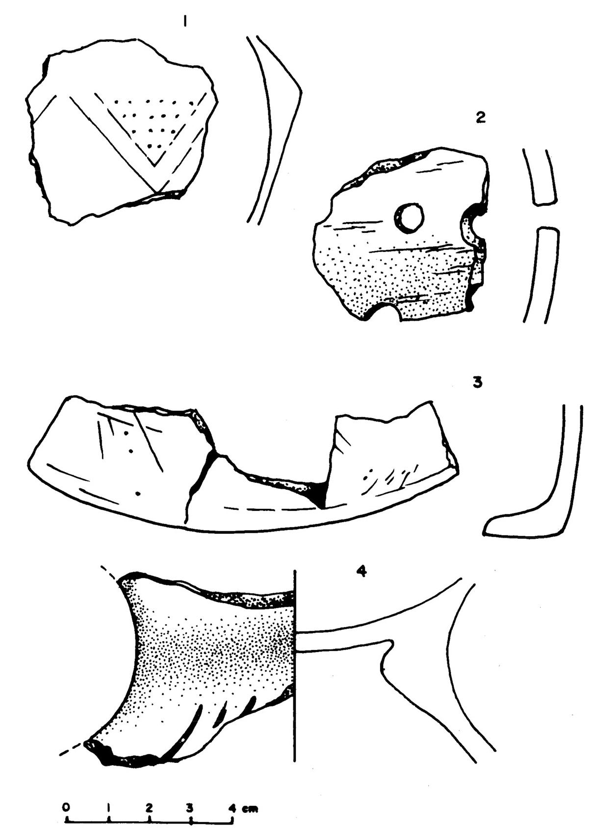 Vörös mázas neolitikus edények töredékei