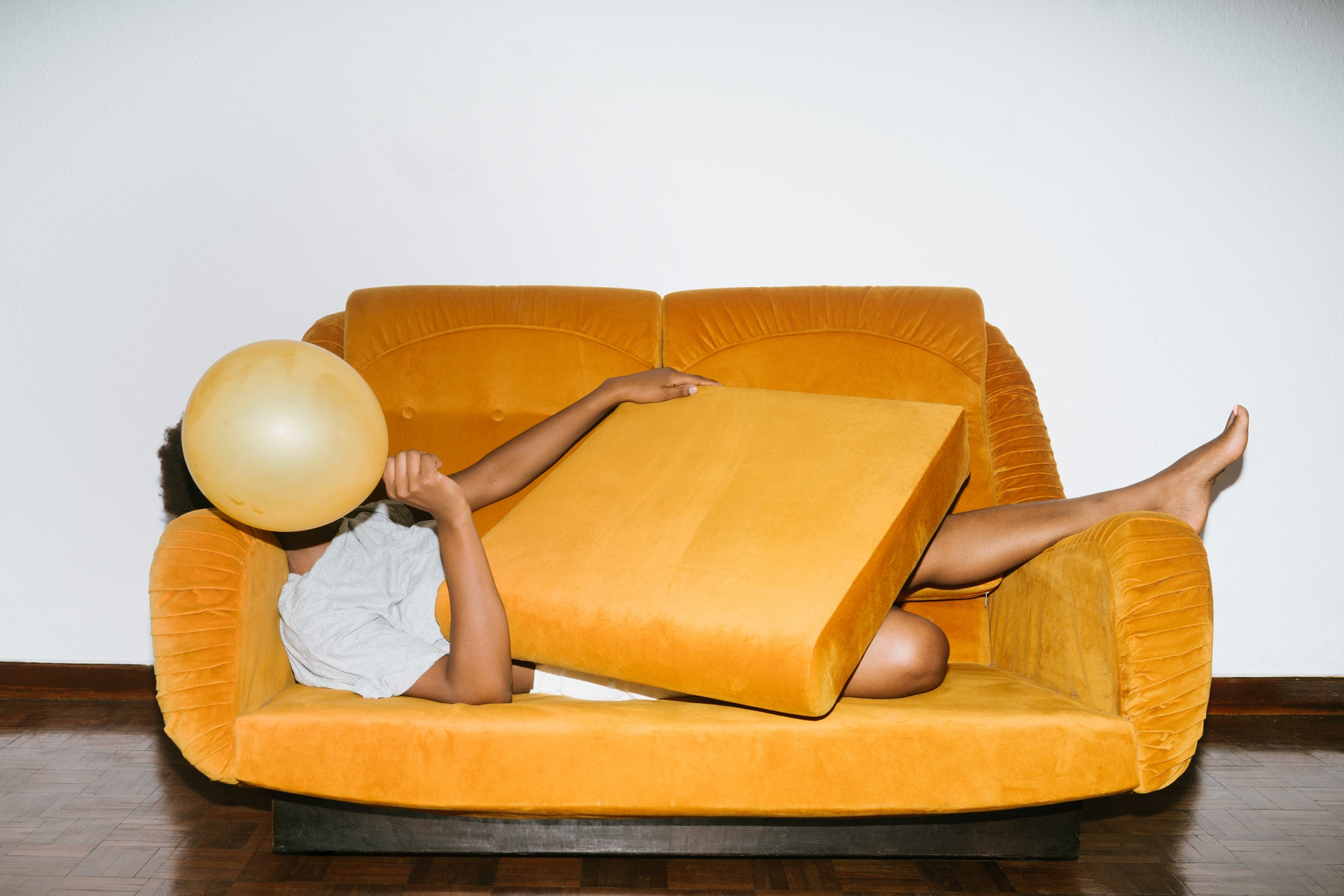 person-lying-on-orange-sofa-3621210.jpg