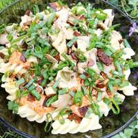 Fusilli with pesto, garlicy roasted mushrooms, green of spring onion and tofu bacon