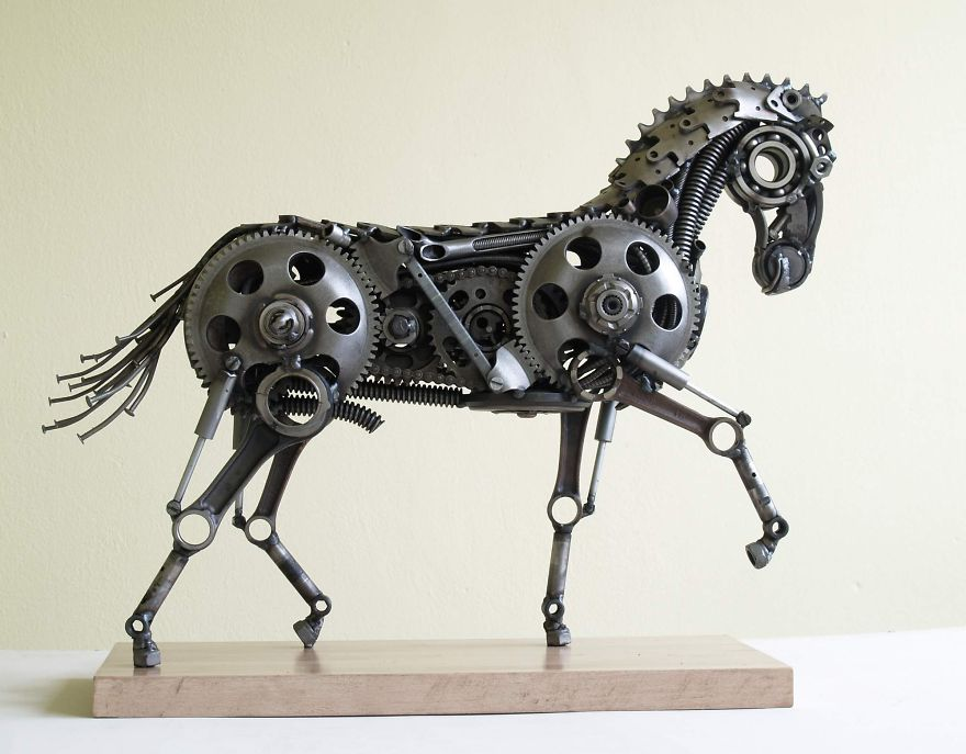 wonderful-sculptures-created-with-recycled-motorbike-parts-15_880.jpg