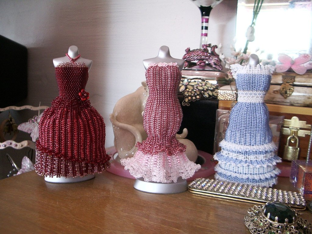 3_bead_dresses_on_dresser_by_pinkythepink-d5cfo4c.jpg
