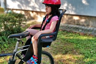 Gyereket a gyerekülésbe, gyerekülést a bringára - de melyiket?
