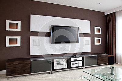 modern-home-theater-room-interior-flat-screen-tv-brown-wall-31863397.jpg