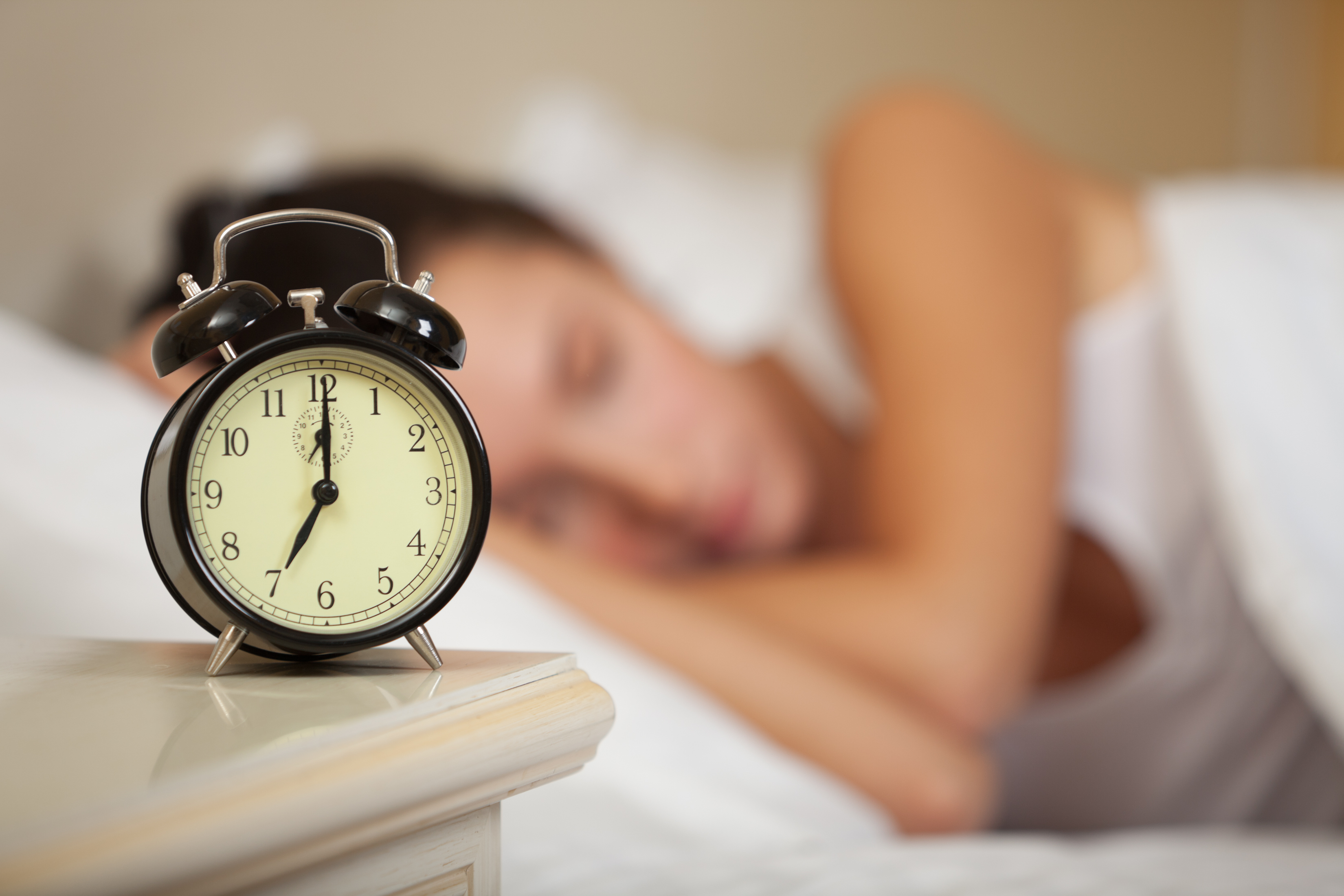 sleeping-woman-and-alarm-clock-bedroom-home.jpg