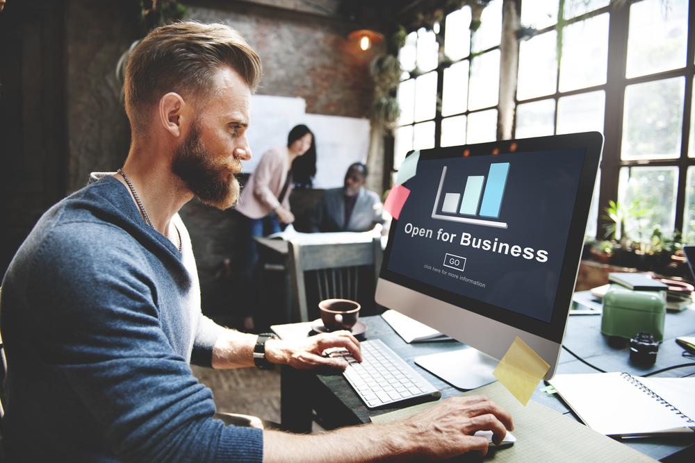 small-business-websites-man-at-computer-open-for-business.jpg
