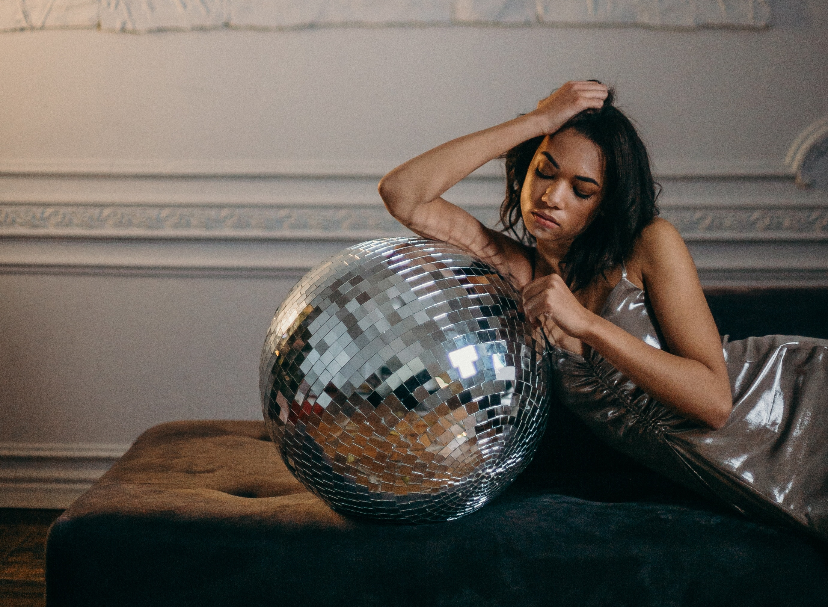 photo-of-woman-leaning-on-disco-ball-3402579b.jpg