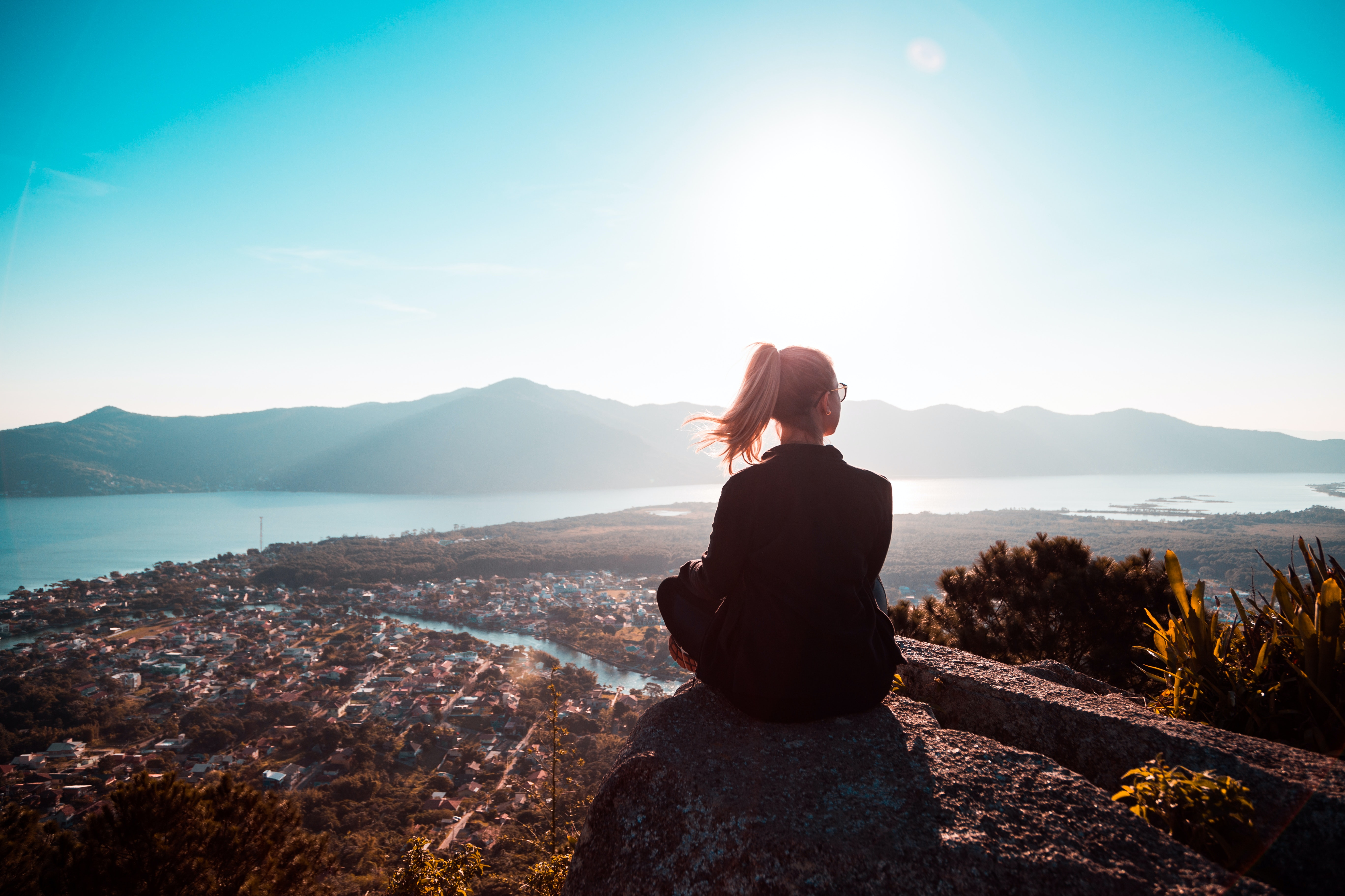 woman-sitting-at-the-edge-of-mountain-2261017.jpg