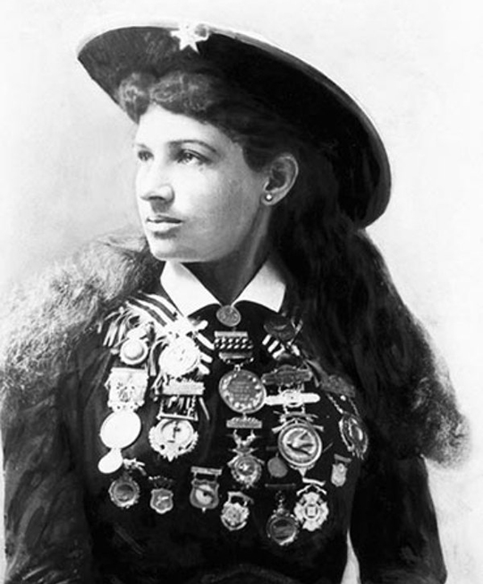 annieoakley-portrait-with-medals.jpg