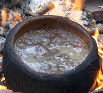 boiling water in a clay pot.jpg