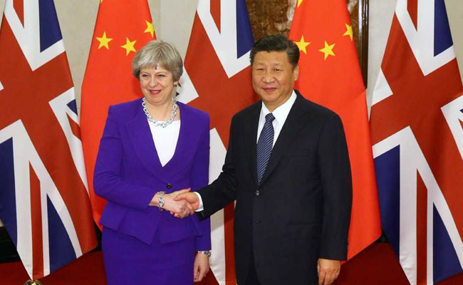 theresa-may-xi-jinping-reuters_650x400_81517557019.jpg
