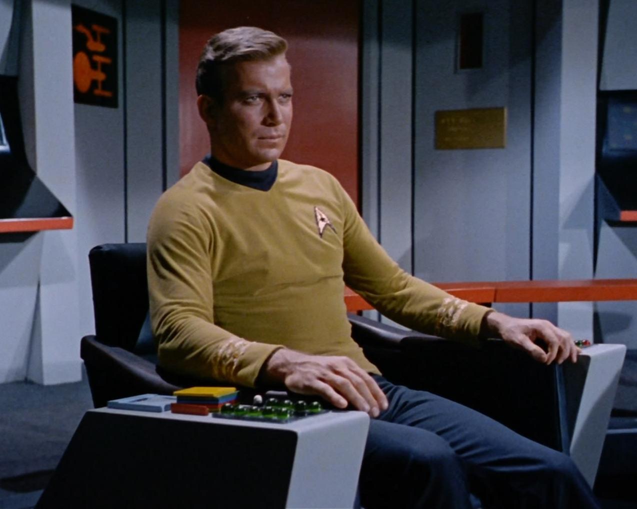kirk_in_enterprise_command_chair.jpg