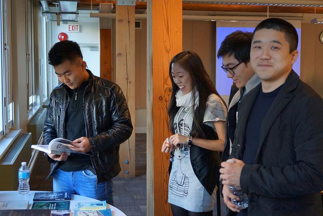 Young Koryo Saram students browsing through the book exhibit.jpg