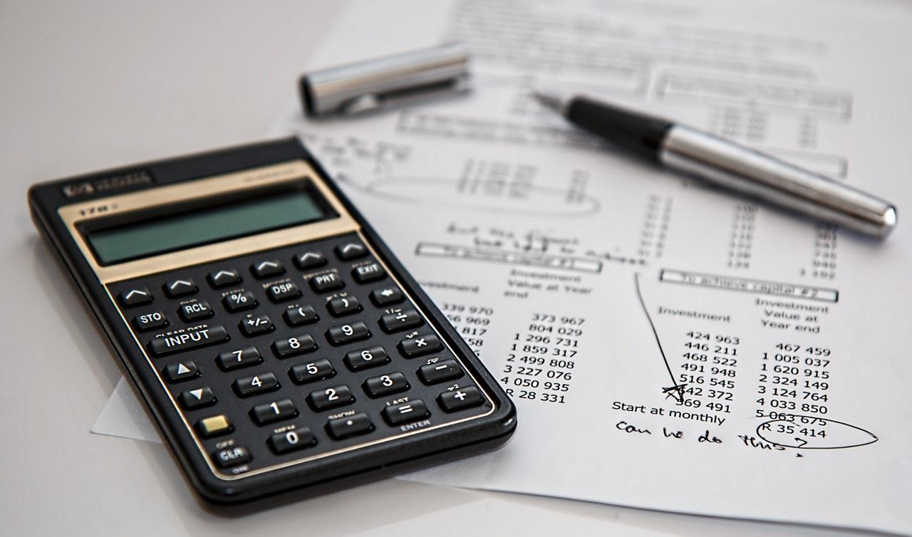 black-calculator-near-ballpoint-pen-on-white-printed-paper-53621_1.jpg