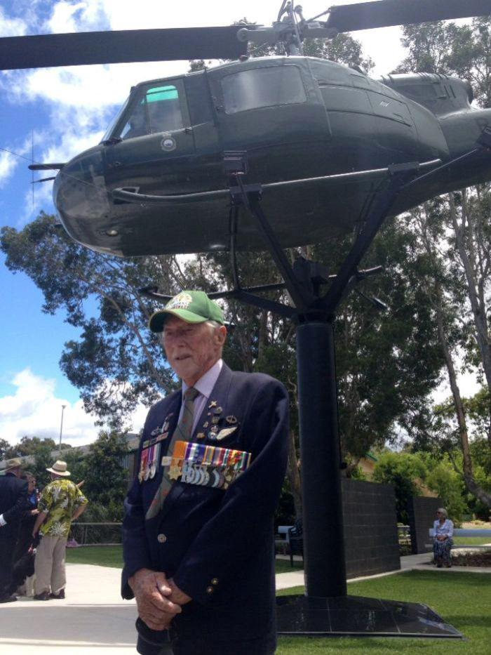 long_tan_commander_harry_smith_and_the_chopper_that_dropped_ammo_during_the_battle.jpg