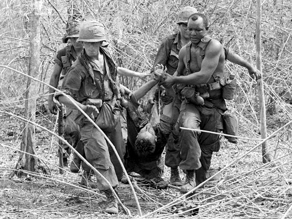 196704_op_junction_city_wounded_comrade_from_16_brigade.jpg