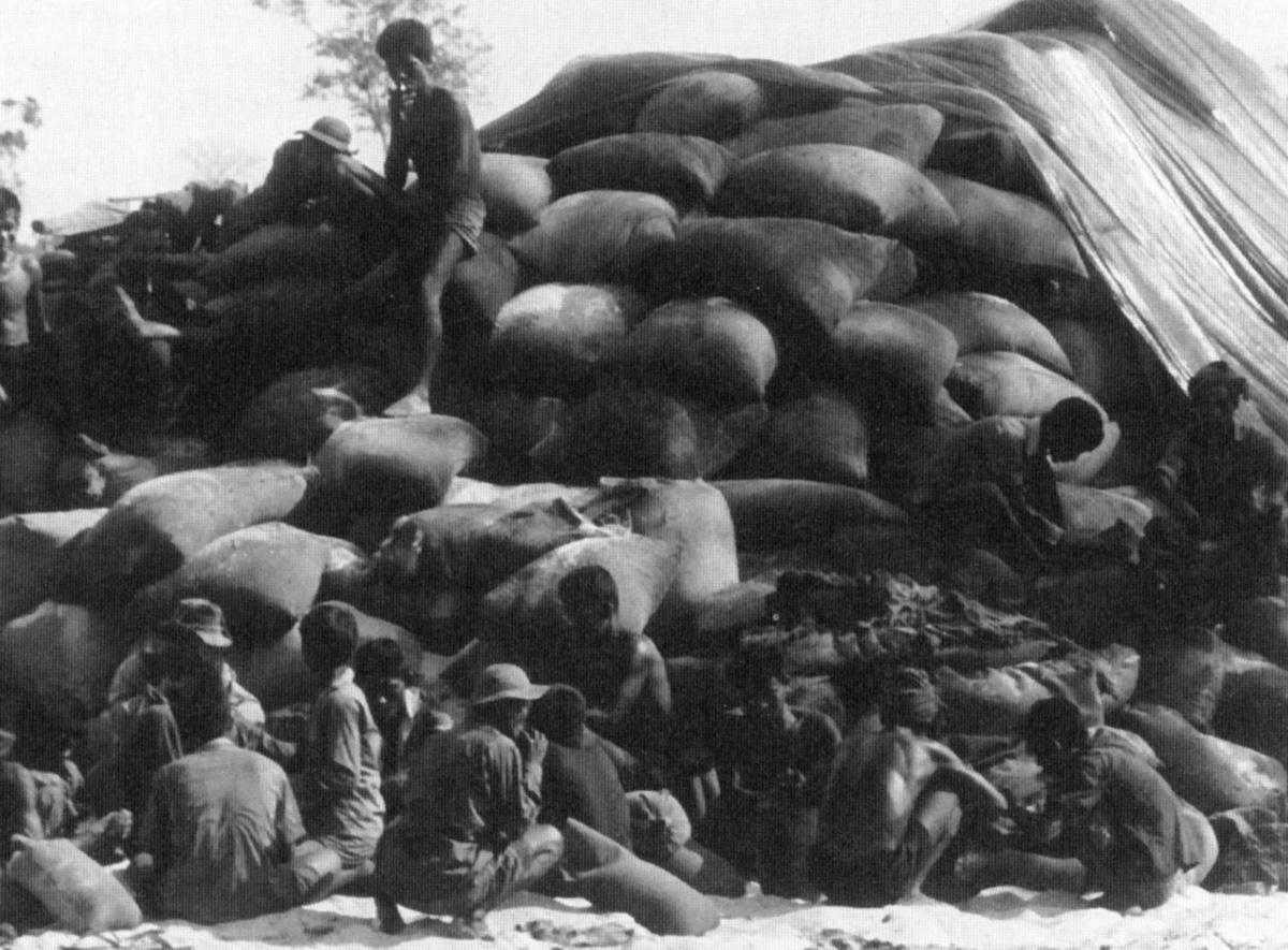cambodian_civilians_bag_up_captured_nv_rice.jpg