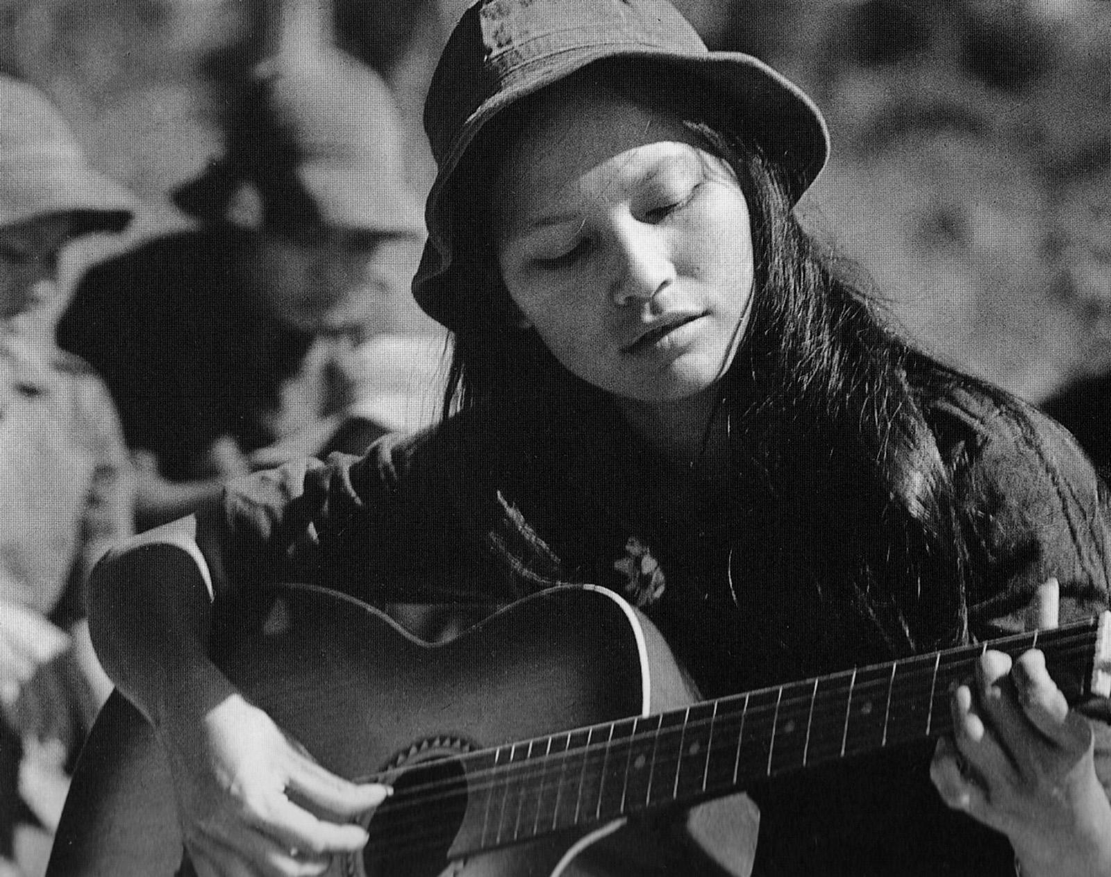 1970_youth_brigade_volunteer_playing_guitar_at_hcm_trail.jpg